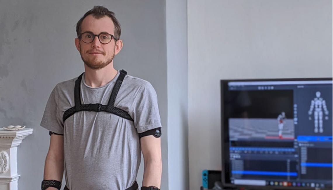 Graphic Artist Ed Vosper wears a Perception Neuron motion capture suit at home.
